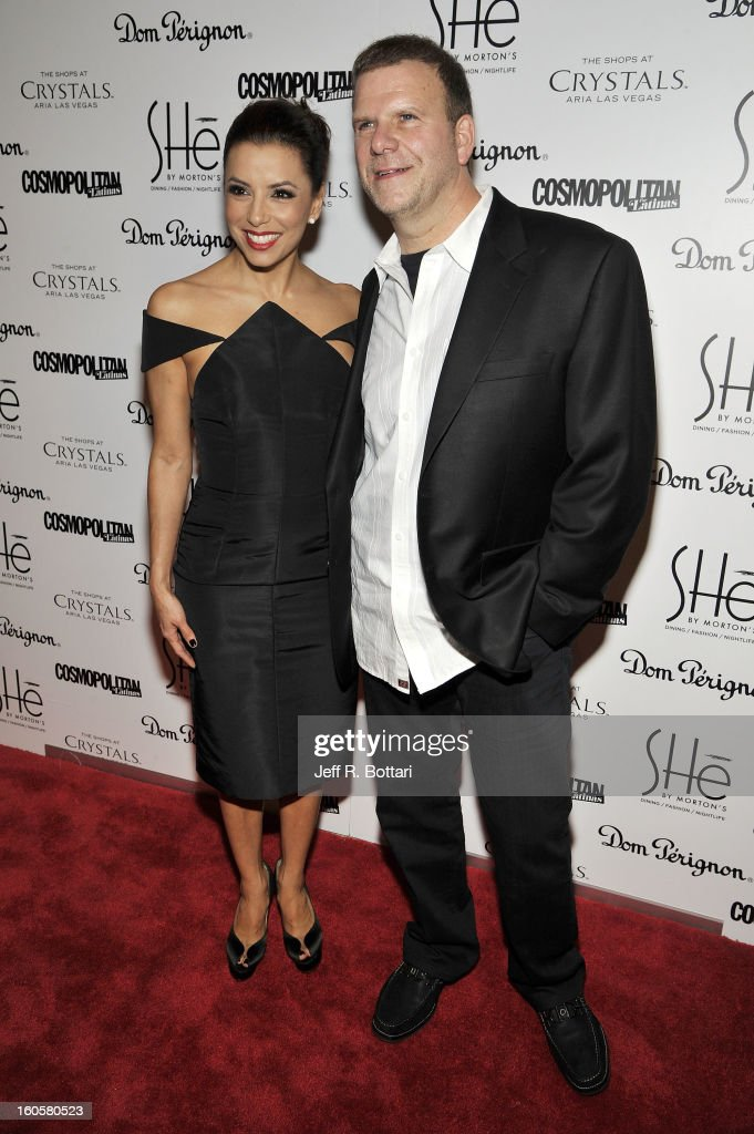 Actress Eva Longoria arrives with Tilman Fertitta (R), President and CEO of Landry's Inc., at the grand opening of SHe by Morton's at Crystals at CityCenter on February 2, 2013 in Las Vegas, Nevada.