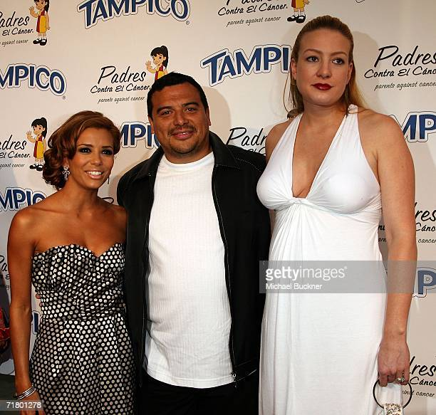 Actress Eva Longoria comedian Carlos Mencia and wife Amy Mencia arrive at the El Sueno De Esperanza Gala at Wisteria Lane on the Universal Studios...
