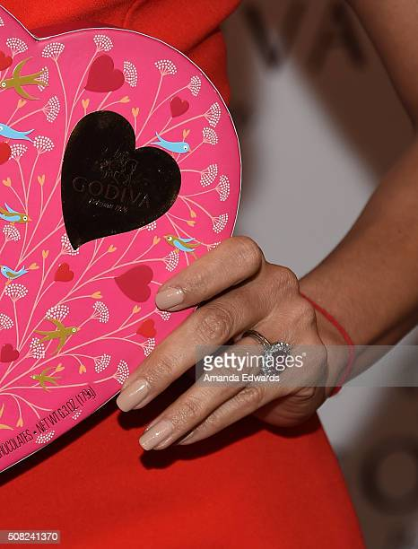 Actress Eva Longoria engagement ring detail celebrates Valentine's Day with Godiva at Godiva Chocolatier on February 3 2016 in Glendale California