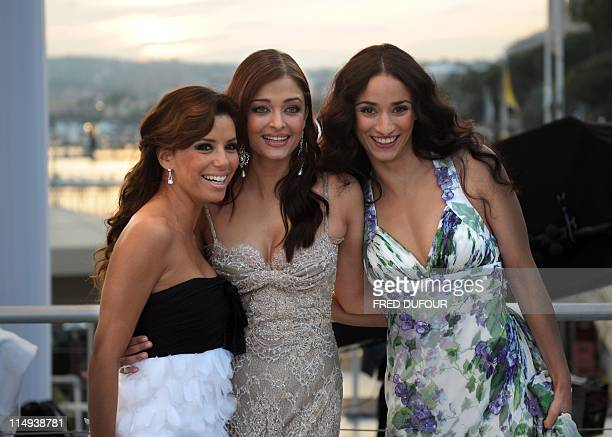 US actress Eva Longoria Parker Indian actress Aishwarya Rai and French actress Rachida Brakni pose on the set of French tv channel Canal Plus during...