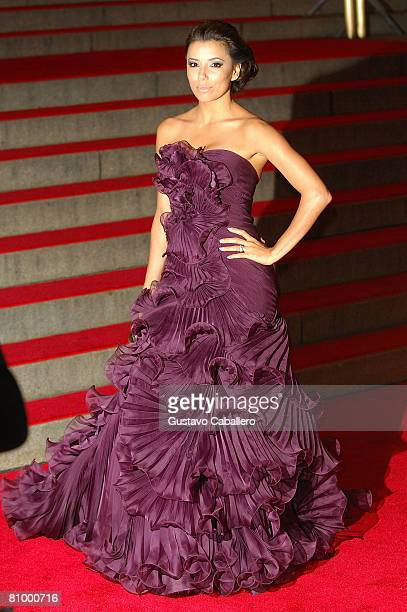 Actress Eva Longoria Parker poses as she departs from the Metropolitan Museum of Art Costume Institute Gala, Superheroes: Fashion and Fantasy, held...