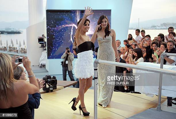 US actress Eva Longoria Parker waves at the crowd next to Indian actress Aishwarya Rai on the set of French tv channel Canal Plus during the 61st...