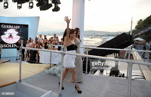 US actress Eva Longoria Parker waves at the crowd next to Indian actress Aishwarya Rai and French actress Rachida Brakni as they leave the set of...