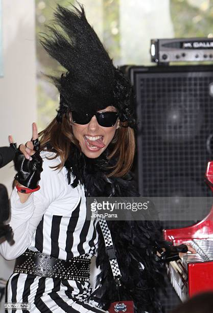 Actress Eva Longoria performs at Gibson Showroom at the Rally for Kids With Cancer pit stop on November 21 2009 in Miami Florida