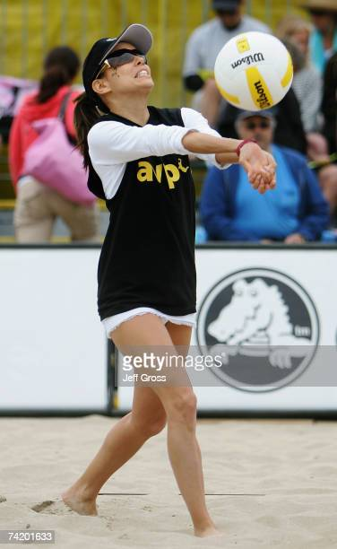 """Actress Eva Longoria plays the ball during the """"Spike for Hope"""" Celebrity Charity Beach Volleyball Tournament at the Hermosa Beach Pier on May 20,..."""
