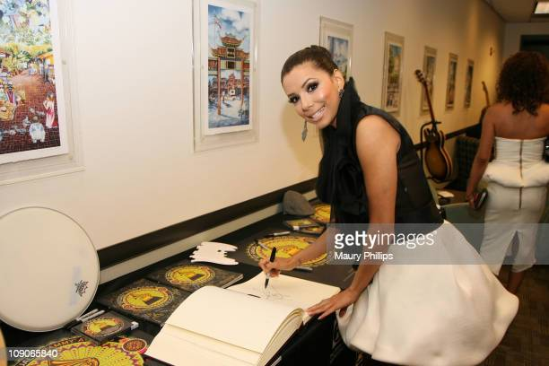 Actress Eva Longoria poses at the MusiCares signing booth during The 53rd Annual GRAMMY Awards held at Staples Center on February 13, 2011 in Los...