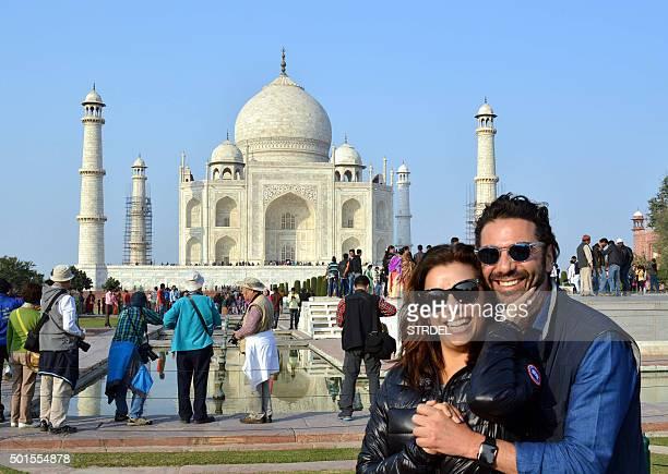US actress Eva Longoria poses with fiance Jose Antonio Baston at The Taj Mahal in Agra on December 16 2015 AFP PHOTO/STR / AFP / STRDEL
