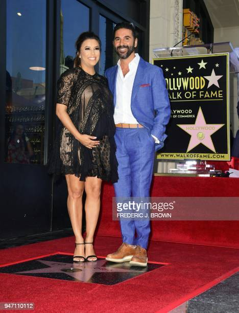 Actress Eva Longoria poses with her husband Jose Antonio 'Pepe' Baston on her Hollywood Walk of Fame Star during a ceremony in Hollywood California...
