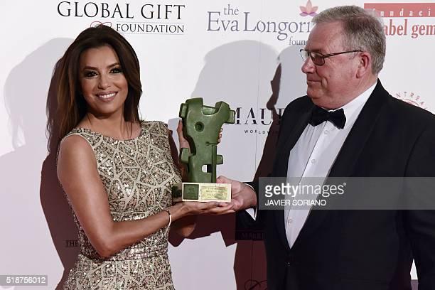 US actress Eva Longoria poses with Rioja's Award beside Spanish Chairman of the Board of the designation of origin for the Rioja wine Jose Maria...