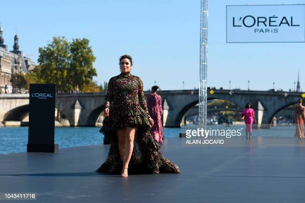 US actress Eva Longoria presents a creation for L'Oreal during the SpringSummer 2019 ReadytoWear collection fashion show in Paris on September 30 2018