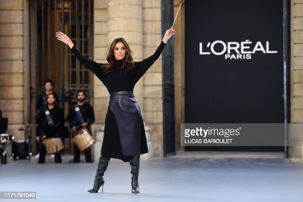Actress Eva Longoria presents a creation for L'Oreal during the Women's Spring-Summer 2020 Ready-to-Wear collection fashion show at the Monnaie de...