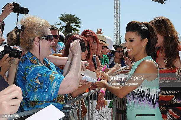 Actress Eva Longoria signs autographs as she arrives to attend a photocall for 'Desperate Housewives' during the 52nd Monte Carlo TV Festival on June...
