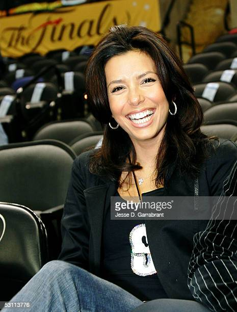 Actress Eva Longoria smiles as she attends Game Six of the 2005 NBA Finals between the Detroit Pistons and the San Antonio Spurs June 21 2005 at SBC...