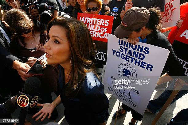 Actress Eva Longoria speaks with members of the media during a break in filming while comedian and actress Wanda Sykes and actress Julia LouisDreyfus...