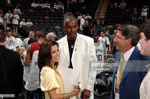 Actress Eva Longoria stands next to Tony Parker's dad Tony Parker Senior before the San Antonio Spurs play the Cleveland Cavaliers in Game One of the...