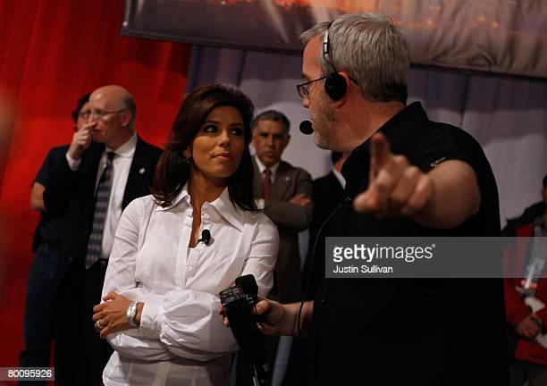 Actress Eva Longoria takes direction before introducing Democratic presidential hopeful Sen Hillary Clinton of New York before the start of a...