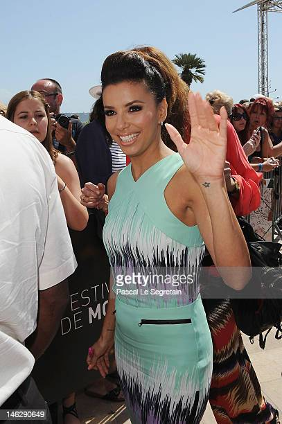 Actress Eva Longoria waves as she arrives to attend a photocall for 'Desperate Housewives' during the 52nd Monte Carlo TV Festival on June 13, 2012...