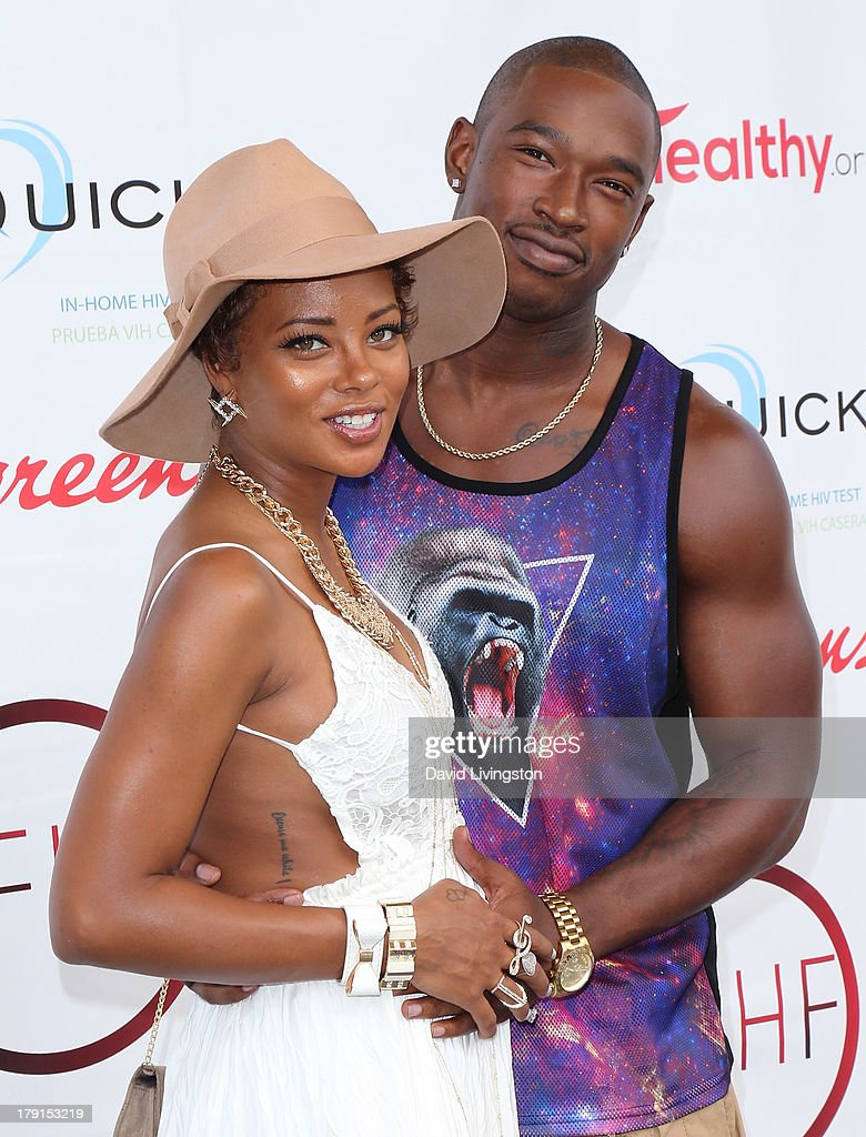 Actress Eva Marcille (L) and singer Kevin McCall attend the Reed for Hope Foundation's 11th Annual 'Sunshine Beyond Summer' celebration at a private residence on August 31, 2013 in Westlake Village, California.