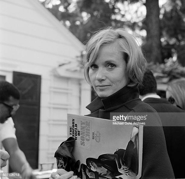 Actress Eva Marie Saint poses with a Sonny and Cher Album in Los Angeles,CA.