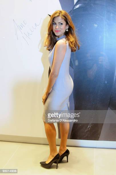 Actress Eva Mendes signs the advertising poster during the launch of Calvin Klein 'Body' Jeans at Calvin Klein Boutique on November 12 2009 in Milan...