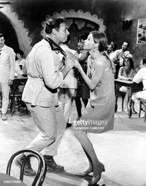 Actress Eva Renzi and George Kennedy in a scene from the movie The Pink Jungle