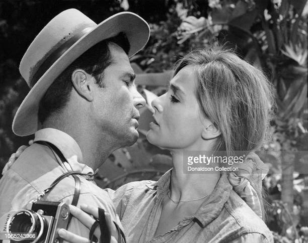 Actress Eva Renzi and James Garner in a scene from the movie The Pink Jungle