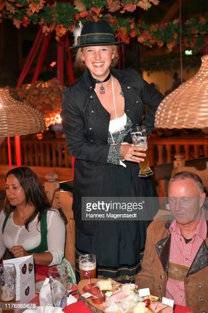 "Actress Eva-Maria Grein von Friedl poses during the ""Fernsehen mit Herz"" Wiesn event during the Oktoberfest 2019 at Kufflers Wine Tent at..."