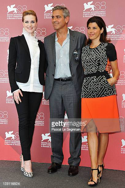 """Actress Evan Rachel Wood, director George Clooney and actress Marisa Tomei pose at """"The Ides Of March"""" photocall during the 68th Venice Film Festival..."""
