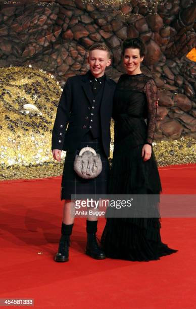 """Actress Evangeline Lilly and actor John Bell attend the """"The Hobbit: The Desolation of Smaug"""" European Premiere at Cinestar on December 9, 2013 in..."""