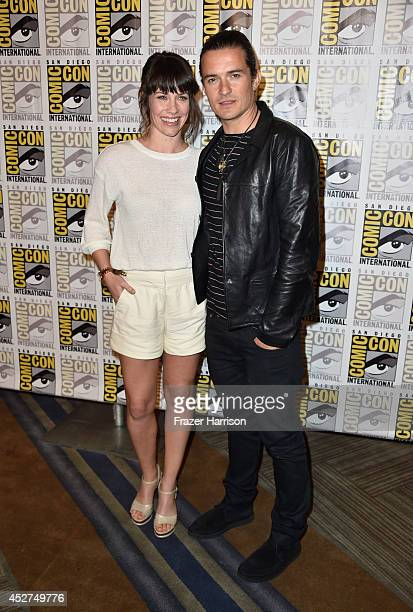 Actress Evangeline Lilly and actor Orlando Bloom attend The Hobbit The Battle Of The Five Armies Press Line during ComicCon International 2014 at...