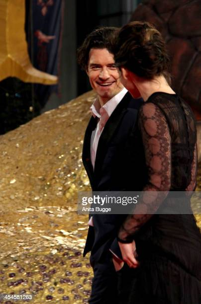 """Actress Evangeline Lilly and actor Orlando Bloom attend the """"The Hobbit: The Desolation of Smaug"""" European Premiere at Cinestar on December 9, 2013..."""