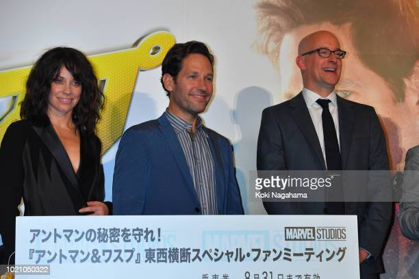 Actress Evangeline Lilly and Actor Paul Rudd and Director Peyton Reed pose for photographs during the 'AntMan And The Wasp' premiere on August 21...