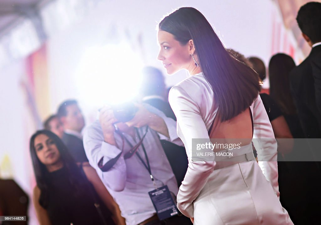 TOPSHOT - US actress Evangeline Lilly attends the World Premiere of Marvel Studios' 'Ant-Man and The Wasp' at the El Capitan Theater, on June 25, 2018, in Hollywood, California.