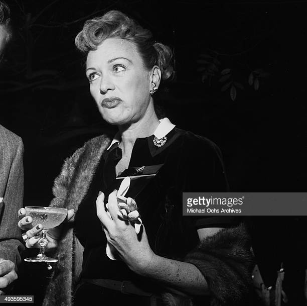 Actress Eve Arden poses at a cocktail party in Los Angeles California