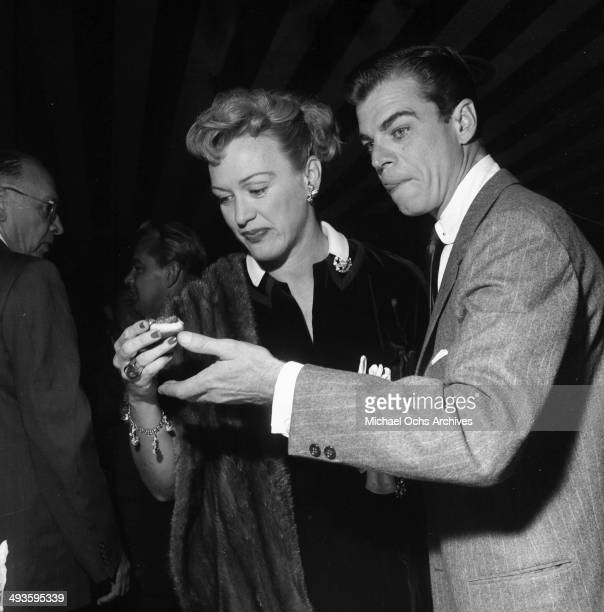 Actress Eve Arden with husband Brooks West attends a cocktail party in Los Angeles California