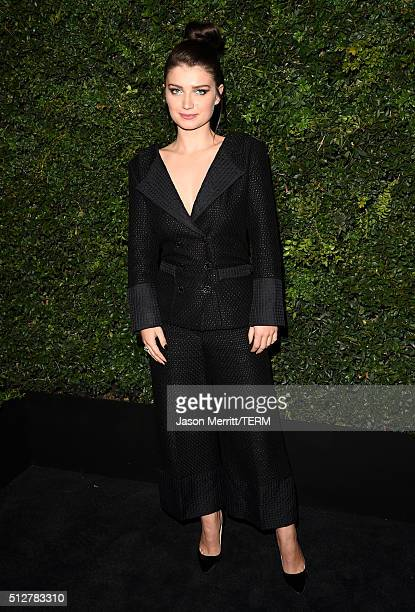 Actress Eve Hewson attends the Charles Finch and Chanel PreOscar Awards Dinner at Madeo Restaurant on February 27 2016 in Los Angeles California
