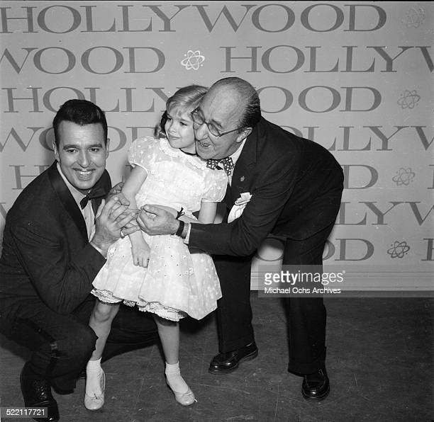 Actress Evelyn Rudie poses with Ernie Ford and Ed Wynn during the Emmy Nominations in Los Angeles,CA.