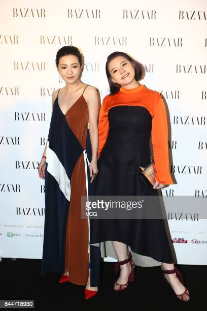 Actress Evonne Xie Yilin and singer Amber Kuo arrive at the red carpet of 2017 Bazaar Star Charity Night on September 9 2017 in Beijing China