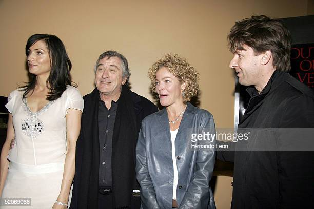 Actress Famke Janssen actor Robert De Niro actress Amy Irving and director John Polson pose for a photo before the premiere of 'Hide And Seek' at the...