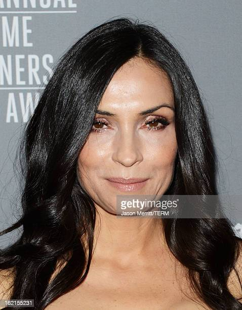 Actress Famke Janssen attends the 15th Annual Costume Designers Guild Awards with presenting sponsor Lacoste at The Beverly Hilton Hotel on February...