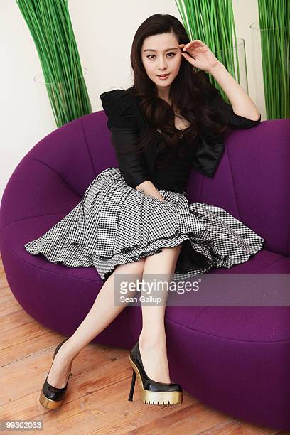 Actress Fan Bing Bing poses during a portrait session for the cast of 'Chongqing Blues' at the Majestic Beach during the 63rd Annual Cannes Film...