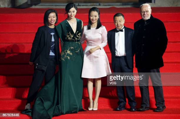 Actress Fan Bingbing actress Zhao Tao and director Jia Zhangke arrive at the red carpet of the 1st Pingyao Crouching Tiger Hidden Dragon...