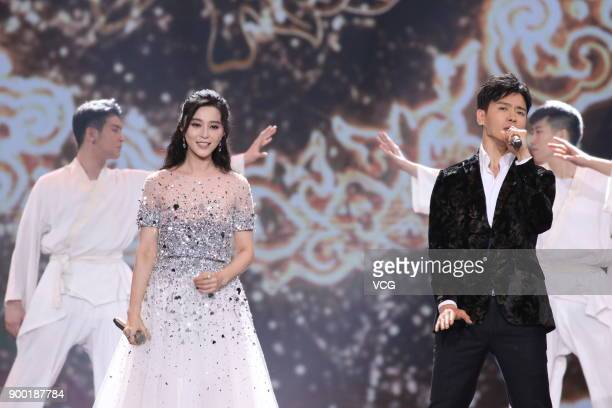 Actress Fan Bingbing and actor Gao Yunxiang perform onstage during the Shanghai Dragon TV New Year's Eve gala on December 31 2017 in Shanghai China