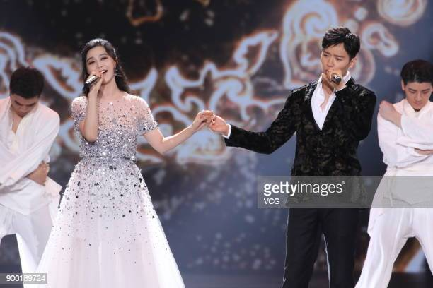 Actress Fan Bingbing and actor Gao Yunxiang perform onstage during the Shanghai Dragon TV New Year's Eve gala on December 31, 2017 in Shanghai, China.