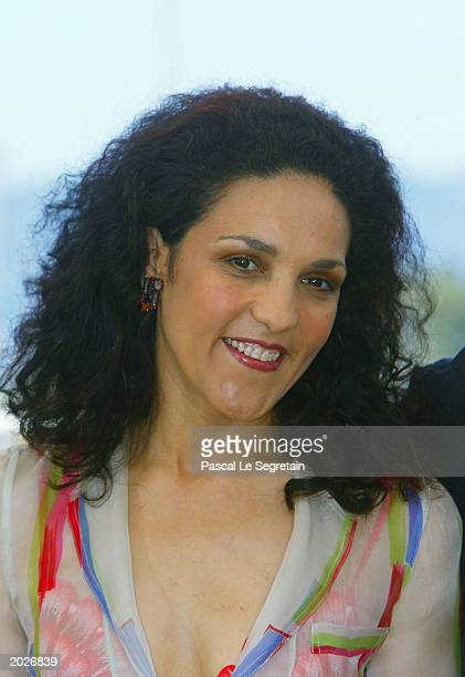Actress Farida Rahouadj poses for the cameras at the photocall for the film Les Cotelettes during the 56th Cannes Film Festival on May 24 2003 at the...