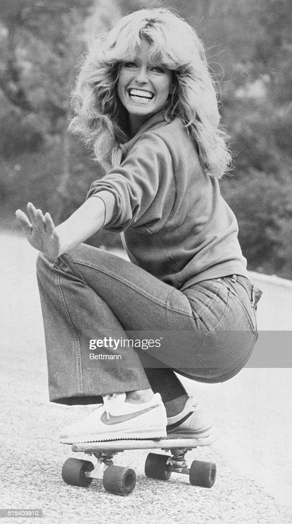 Actress Farrah Fawcett, wearing jeans, sweatshirt and Nike athletic shoes, practices skateboarding for an episode of Charlie's Angels.