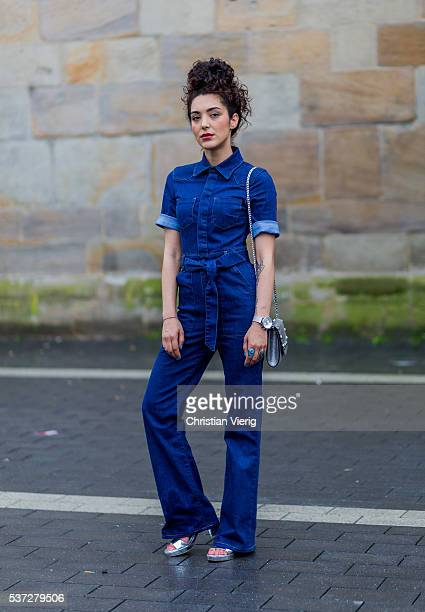 Actress fashion and travel blogger SaraJoleen Kaveh Moghaddam wearing a navy blue Asos denim jeans overall a silver Delage bag and silver Zara shoes...
