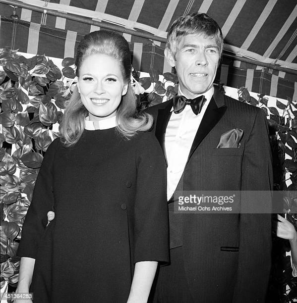 Actress Faye Dunaway and actor James Coburn arrive to a party in Los Angeles California