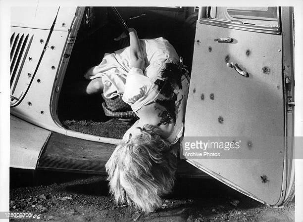 Actress Faye Dunaway lying dead in a car in a scene from the film 'Bonnie And Clyde', 1967.