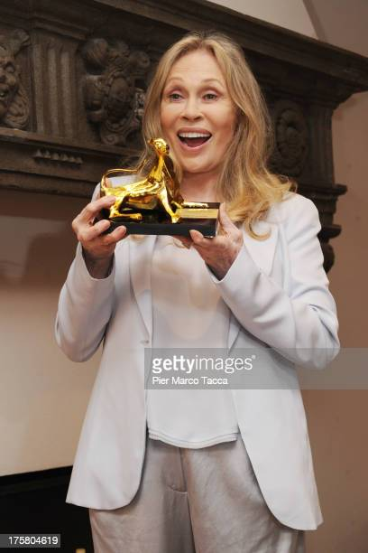 Actress Faye Dunaway poses with Leopard Club Award during the 66th Locarno Film Festival on August 8 2013 in Locarno Switzerland